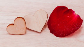The wooden hearts on wooden background. Royalty Free Stock Photos