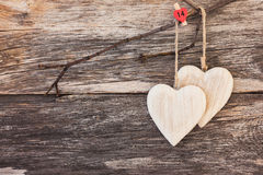 Wooden hearts on wooden background. Copy space, soft focus, toned, vintage style Stock Photos