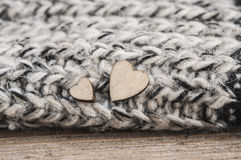 Wooden hearts on woolen scarf Royalty Free Stock Images