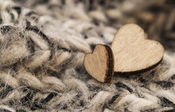 Wooden hearts on woolen scarf Stock Images