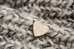 Wooden hearts on woolen scarf Stock Image