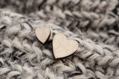 Wooden hearts on woolen scarf Royalty Free Stock Photos