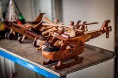 A wooden helicopter toys line in store market in malioboro jogja yogyakarta indonesia. Java Royalty Free Stock Images