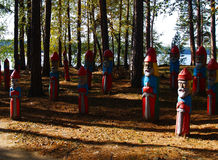 Wooden hero sculptures on autumn forest Stock Photography