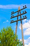 Wooden high-voltage power lines support. blue sky with clouds. Electrical industry. Russia. Siberia. Power station. Royalty Free Stock Image