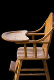 Wooden highchair black background Stock Image
