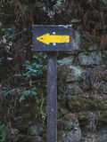 Wooden hiking trail signpost in oak forest Royalty Free Stock Photography
