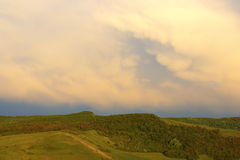 Wooden hills under stormy sky Royalty Free Stock Photography