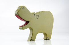 Wooden Hippo Three Quarter on White. A painted wooden hippo toy on a white backgroud with a three quarter view Stock Photos