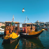 Wooden historic boats at Douro river, in area Ribeira. Royalty Free Stock Photos