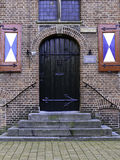 Wooden historic door. Of a former monastery and school in Zwolle, the Netherlands Stock Photo