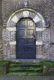 Wooden historic door. View of a historic wooden door of a church in Zwolle, the Netherlands Royalty Free Stock Photo