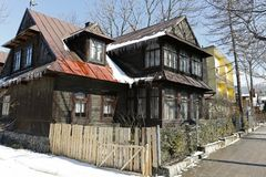 Wooden historic house by the street during winter Royalty Free Stock Photo