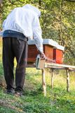 Wooden hive for bees, beekeeping, honey, health, healthy life. Active men stock photography