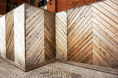 Wooden Hoarding. Chevron patterned wooden hoarding protecting and shielding a building or renovation site Royalty Free Stock Images