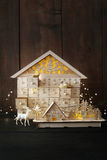Wooden holiday houses with lights Stock Image