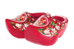 Wooden Holland shoes. Red holland shoes on a white background stock photo