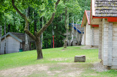 Wooden home sides row in green summer park. Wooden holiday home sides row in the green summer park Royalty Free Stock Images