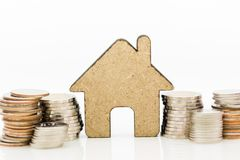 Wooden home with stack of coins. Image use for background money, financial, insurance concept.  Royalty Free Stock Image