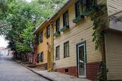 Wooden Homes, Istanbul. ISTANBUL, TURKEY - JUNE 5, 2016: Wooden homes on a steep road in Edirnekapi, a suburb in the west of Istanbul, Turkey Stock Images