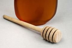 Wooden honey stick Stock Photos
