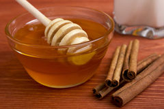 Wooden Honey Stick And Cinnamon Sticks. Royalty Free Stock Images