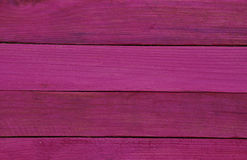 Wooden horizontal dark pink background Royalty Free Stock Images