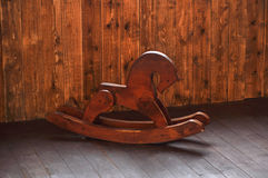 Wooden horse for children. Children`s toy in the form of a wooden horse stock photography