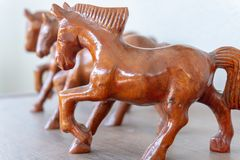Wooden horse figurine on a blurred background. stock photo