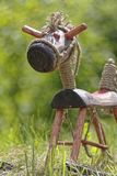 Wooden horse on grass. Hand made wooden horse on green grass Stock Photo