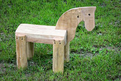 Wooden horse. On a green grass Royalty Free Stock Photo