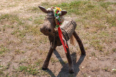 Wooden horse made by hand with Ukrainian colorful hat on his hea Royalty Free Stock Photography