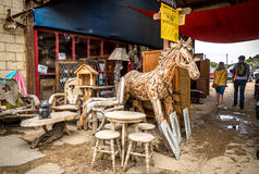 Wooden Horse in a Market Stall. A large hand crafted wooden horse, made from reclaimed wood can be found in a local market bazaar stall, along with many other Royalty Free Stock Photo