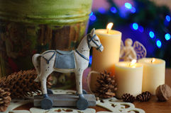 Wooden horse for new year. With candles and cones Royalty Free Stock Photos