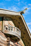 Wooden horse on the roof and a balcony Royalty Free Stock Images