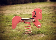 Wooden horse with spring in the playground Royalty Free Stock Photo