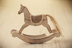 Wooden horse toy. Old rocking horse on a rustic country backdrop Royalty Free Stock Image