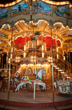 Wooden horse on vintage carousel in Paris, France. Old carousel with wooden horse in Paris, France Stock Photos