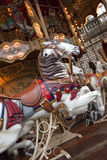 Carousel at a fairground. Wooden horses on a carousel at a fairground Royalty Free Stock Photography