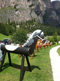 Wooden horses for childs in a mountain hut Stock Photos