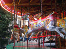 Wooden horses on a fairground ride. Royalty Free Stock Photos
