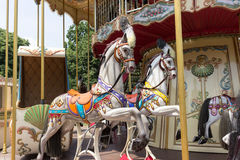 Wooden horses on french carousel. White wooden horses on the french carousel Royalty Free Stock Photo