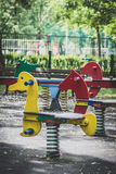 Wooden horses with spring in the park. Wooden horses with spring on the playground in the park Royalty Free Stock Photography