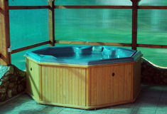 Wooden hot tub. Filled with water stock images