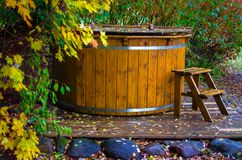 Wooden hot tub with a ladderv. Rural wooden water hot tub with stairs garden yard stock photography