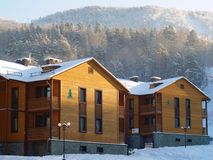 Wooden hotel in the mountains Stock Photos