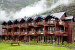 Wooden hotel in mountains Stock Images