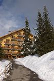 Wooden hotel in winter forest Royalty Free Stock Photos