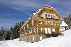 Wooden hotel in winter Royalty Free Stock Photo