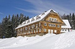 Wooden hotel in winter Royalty Free Stock Photos